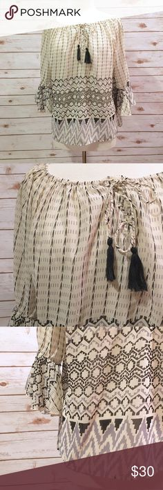 "NWT Umgee Ivory Printed Bohemian Blouse Chic bohemian blouse by Umgee. ▪️25"" long ▪️26"" pit to pit ▪️16"" arm length ▪️NWT from boutique ▪️In great condition   🚭 Smoke-free home 📬 Ships by next day 💲 Price negotiable  🔁 Open to trades  💟Happy Poshing!💟 Umgee Tops"