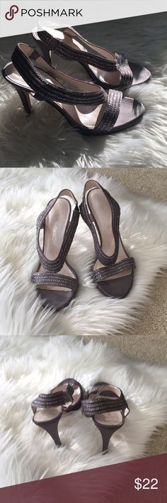 Caparros heels Beautiful pair of Caparros dress heels in a pewter color . Worn to one black tie event .Beautiful shoe for prom or wedding season .. Caparros Shoes Heels