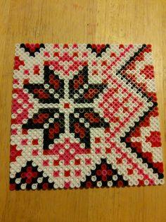 Christmas star design perler bead by Sara Swope