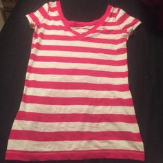 Red and Striped Abercrombie T-shirt This is a Large Ambercrombie kids top, however it fits like an adults small. Please be aware of this before purchasing. It is super cute, red and white striped. Light weight T-shirt. There is a moose embroidered on it (shown on picture). No trades but am open to reasonable offers Abercrombie & Fitch Tops Tees - Short Sleeve