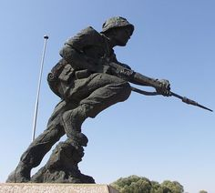 """Statue of a uniformed soldier, part of the official memorial to the SADF at Fort Klapperkop. Almost all white, male South Africans now between the ages of around 35 and 60 donned the nutria brown uniform of the South African Defence Force (SADF). Between 1967 and 1994, approximately 600,000 young men were conscripted to perform national service, or diensplig. Failure to do so meant harsh penalties. alternatives were """"religious"""" grounds: face a six-year jail sentence, or to flee the country."""