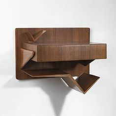 Wright - Wall mounted nightstands - I love these...with the slanty places