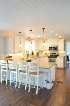 I LOVE this kitchen!! wood planked ceiling