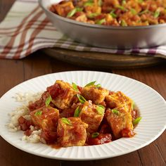 A vegetarian recipe of fried tofu tossed in a simple tomato sauce flavored with soy sauce and chili garlic sauce