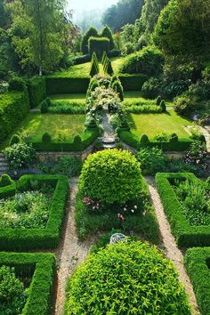 Hedges, pillars and paths work together in this formal Garden