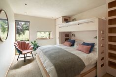 Bunk room with a double bottom bed and single top bed with storage built into the frame.  A shell chair sits by the window Built In Storage, Bed Storage, Devon House, Bunk Beds, Shell, Windows, Chair, Building, Frame