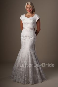 The Telluride | Glow with bridal beauty in this striking mermaid wedding gown. Featuring a lovely lace, rich color, sweetheart neckline and scalloped finish, this dress will complete your dramatic entrance.    Gown available in Champagne/Ivory, Ivory or White.    *Gown pictrued in Champagne/Ivory.     Available at LatterDayBride.com or in Store Located in Salt Lake City, Utah