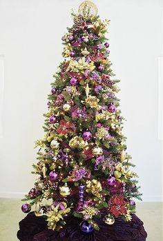Sugar Plum....Purple is my favorite color but I'm too much of a traditionalist for ths to be my only tree. I would love it as an additional tree, We actually put up 3 trees every year,
