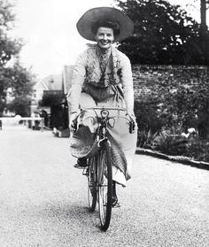 Katharine Hepburn rides a bike.