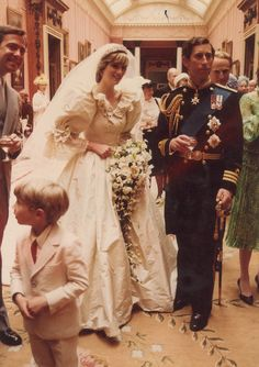 Princess Diana is seen holding five-year-old Clementine Hambro, her youngest bridesmaid, as the Queen walks by her side Captivating.....