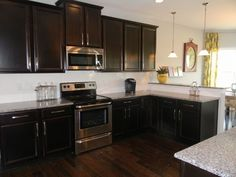 Espresso Kitchen Cabinets with Black Appliances | espresso cabinets with saddle floors - Google Search