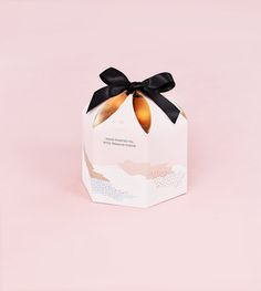 Beautifully packaged Tea - pale pink, blush with rose gold insert. The black bow gives a classy, elegant finish.