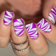 """Watermarble nails using @colorclubnaillacquer Right On as the base and watermarble with @sally_hansen Lets Snow, Color Club Harp On It, and…"""