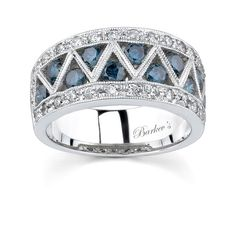 White Gold Band With White & Blue Diamonds - 6094LBDW - This unique, classic styled, white gold diamond band features a center row of channel set blue diamonds artfully encased by white gold bars for a dramatic appearance.  Framing  the center design are pave set white diamonds; a milgrain finish adds the final touch of elegance to set this band apart from it's competition.%0D%0A%0D%0AAlso available in 18k and Platinum.