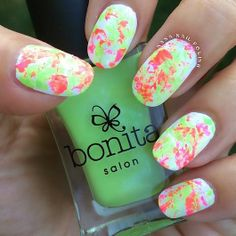 Neon splatter nails~ Use an old toothbrush to flick the nail polish onto your nails.
