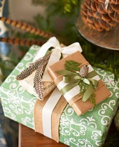 Dress up your packages with fresh ideas for paper, ribbon and other decorations.Burlap and feathers are unconventional trimmings on beautiful packages. TIp: Wrap gifts early and use them as holiday decor!