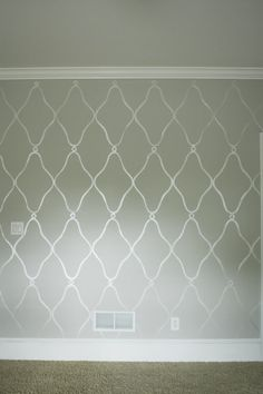 Example of grey room with metallic stencil
