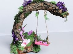 Have you ever seen a fairy garden? It is a miniature garden, a small magical world you can create in a flower pot or garden bed. This project is fun for the whole family. A fairy garden is a combination of a mini garden and an outdoor doll house. Mini Fairy Garden, Fairy Garden Houses, Fairies Garden, Fairy Garden Furniture, Backyard Furniture, Outdoor Furniture, Fairy Village, Fairy Crafts, Cute Fairy