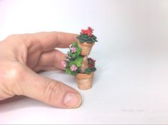 Garden planter.Miniature terracotta flowerpot tower with geraniums.Handmade plant.Dollhouse spring decoration.. €20.00, via Etsy.