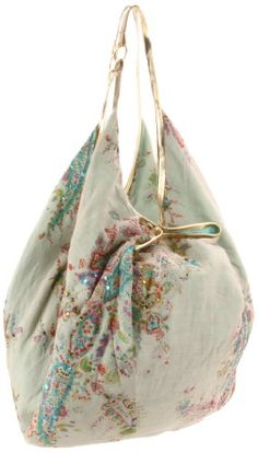 Another cute fabric purse, I have my share of deco fabric that might just work for a couple of these.  Got me thinking!
