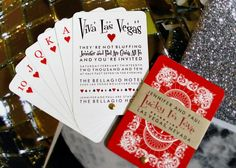 Playing Card Wedding Invitations by @Anticipation ::  An Invitation Studio  perfect for a Vegas destination wedding! This design features a five card hand with red or black card backs featuring our couple-in-love logo, announcement card, mailing card, and separate RSVP. The cards are joined on an aluminum pivot, wrapped in a coordinating kraft paper band, and ready to mail in our attention-grabbing clear box (also included). $8-9 an invite.