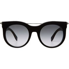 """Finished with a hand-set """"""""piercing bar"""""""" atop jet black frames, these round sunglasses from Alexander McQueen are a bold choice for every day. Lightly tinted…"""