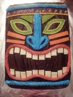 Tiki mask hawaii 50 chocolate cake I made w colored chocolate and frosting