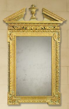 A George IIparcel-gilt green-paintedpiermirror in the manner of William Kent circa 1730  Sotheby's