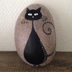 Black cat on stone....