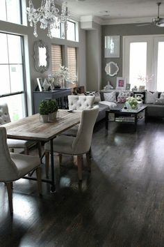 I like this rustic & contemporary dining/living room combination