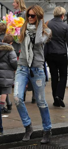 elle macpherson in a comfy sweater + scarf + ripped jeans