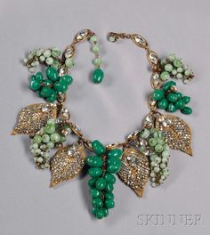 Impressive Vintage Grape Cluster Festoon Necklace, Miriam Haskell, c. 1950s, designed by Frank Hess, the clusters of pate de verre beads and prong-set strass, alternating with gilded metal leaves covered entirely with roses montees, suspended from gilded metal and marquise-shape strass chain, lg. to 16 in., unsigned.