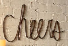 "Junkyard Beauty - ""Cheers"" Scrap Metal Sign    $32.00@http://antiquefarmhouse.com/current-sale-events/recycled-upcycled-junk2.html"