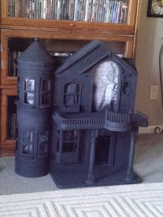 not obsessed with this one but love the idea of turning an old plastic dollhouse into a haunted house