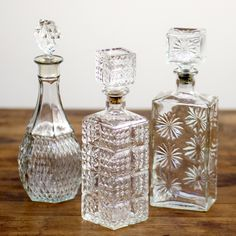 """decanters: Clear+decanters+with+lids+range+in+size+from+8""""+tall+to+10""""+tall."""