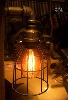Industrial Wall Light. Sconce with vintage style Edison bulb and wire cage.