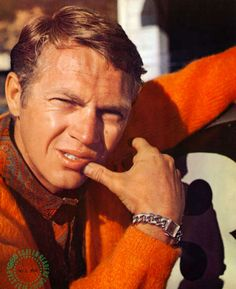 steve mcqueen in an orange sweater