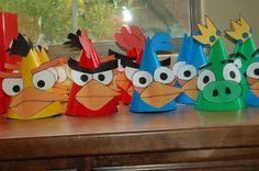 Angry Birds party hats. Great idea!   Just use regular primary-colored hats and use these free templates to decorate with (can use them on your balloons as well)!   http://www.thepartyanimal-blog.org/Downloads/Angry_Birds_Balloon_Templates.pdf