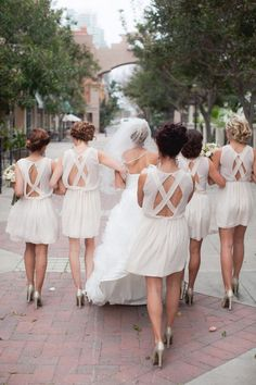 Love the bridesmaid dresses- very unique and pretty!