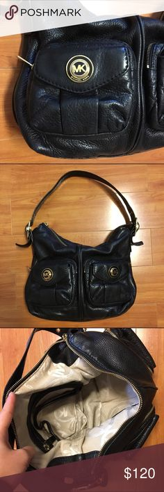MICHAEL KORS Black Leather Purse Authentic Michael Kors leather shoulder hobo bag with gold metal details. Perfect for all seasons and has generous room. Can fit a large wallet, sunglasses and accessories. Inside contains 4 pockets and 1 zipped pocket. Front of bag has 2 large pockets with additional little pockets. Inside has signature MK monogrammed pattern. Good condition. MICHAEL Michael Kors Bags Shoulder Bags