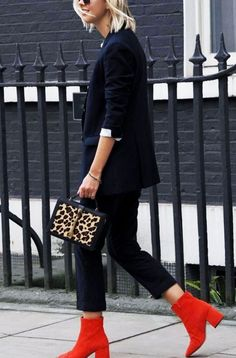 Red block heeled booties with all black outfit and leopard purse. See more at www.HerFashionedLife.com