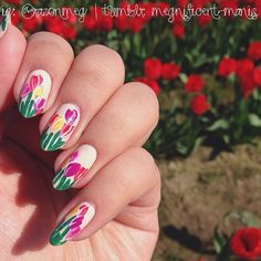 {Matchy-matchy #nails at The Skagit Valley Tulip Festival!  It's a gorgeous, sunny day out in Mount Vernon, WA! WARNING: I'll be spamming my feed with pretty #tulips! #sorrynotsorry}  #megnificentmanis #meglacqsit #nails #nailart #nailsdid #nailstagram #nailartoohlala #nailartswag #nailartclub #nailartjunkies #barbiefingers #queennails #nails2inspire #nailsofinstagram #NOTD #NOTW #floral #flowers (at Tulips.com)