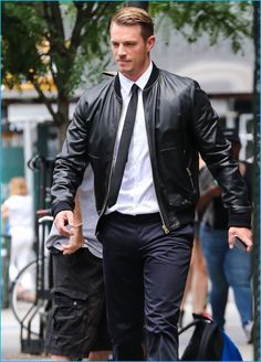 New York Minute: Joel Kinnaman takes the city by storm, sporting a leather bomber jacket with a shirt, tie, and trousers.