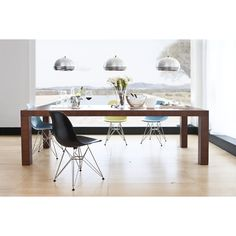 Do not go gently into that decorating scheme—go bold with the Bold Rectangular Dining Table. This broad and bold dining table comes in several sizes to embolden your modern dining room, no matter what the size.      Table: http://www.inmod.com/linea-collection-bold-rectangular-dining-table.html  Chair: http://www.inmod.com/eames-style-molded-fiberglass-side-chair.html