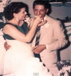 Patsy Cline and her husband, Charlie Dick at the wedding reception.