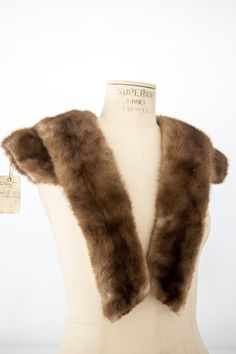 {VINTAGE} As part of our Vintage Goods section, this Vintage Mink Fur Stole Wrap is a beautiful garment from the 50s. An elegant piece to embellish your wardrobe these fall + winter seasons, this stole is made from real mink fur from the USA.Please note, Vintage Goods are final purchase and cannot be returned. These pieces may be aged, have chips or cracks or peeling paint due to the nature of their age and use. Fall Fashion Trends, Autumn Fashion, Black Tie Formal, Mink Stole, Winter Season, Fall Winter, Winter Formal, Vintage Fur, Traditional Fashion