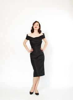 1950s Cocktail Dress - 50s Dress - Elegant Black Silk. $178,00, via Etsy.