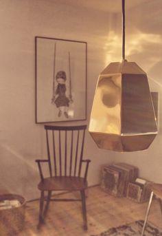living room, wooden floor, rocking chair, banam girl on a swing, golden lamp, vinyl