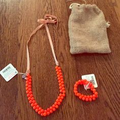 Adorable orange jewelry set! Super cute orange, pearl-like beaded bracelet and necklace from crew cuts (children's J. crew). NWT and with original bag! J. Crew Jewelry