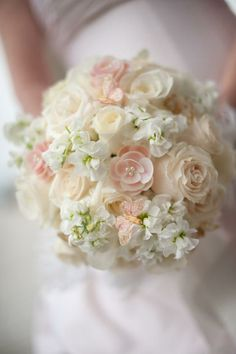 This is a perfect bouquet for me, not sure about bridesmaids. The butterflies and pearl looking things aren't necessary - shoot, even the specific flowers aren't necessary
